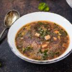 45 degree angle of a bowl of Mushroom Kale Miso Soup