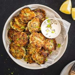 top down view of zucchini fritters with yogurt dip
